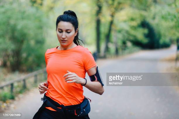 young woman running in berlin, tiergarten park - one young woman only stock pictures, royalty-free photos & images