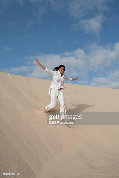 Young Woman Running In Desert