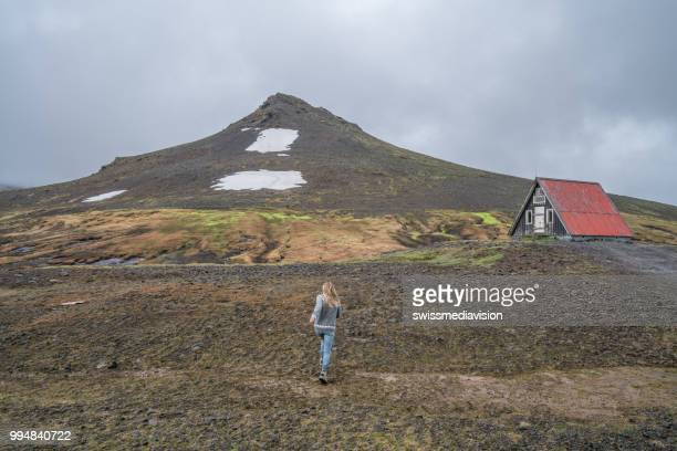 Young woman running in meadow in Iceland