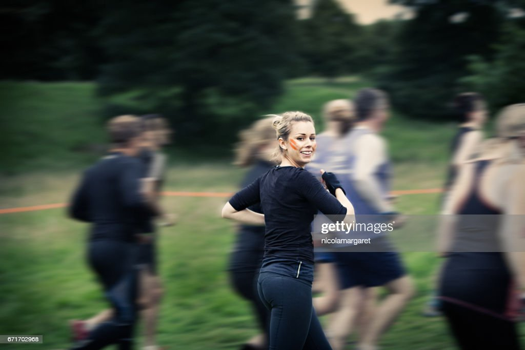 Young woman running in race : Stock Photo