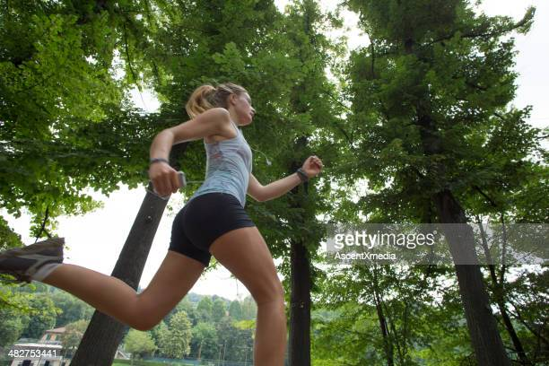 Young woman running in urban park