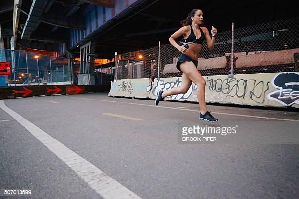 Young woman running in urban setting