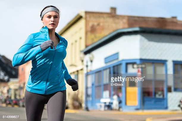 Young Woman Running Jogging in Mountain Town