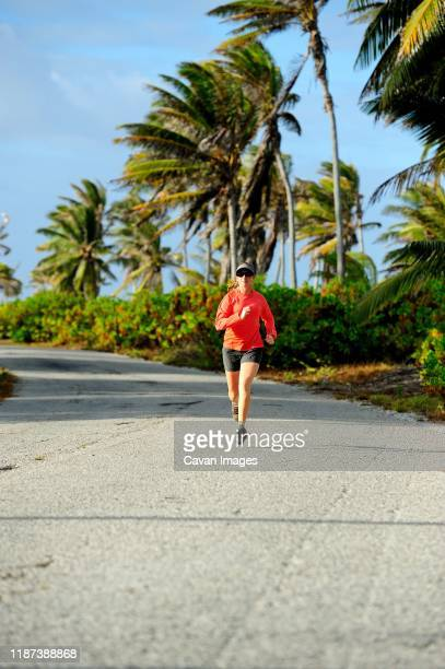young woman running on a sunny day on christmas island - christmas island stock pictures, royalty-free photos & images