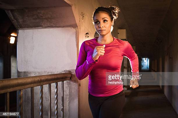 young woman running on city bridge - heshphoto stock pictures, royalty-free photos & images