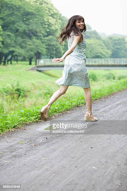 Young Woman Running on Country Road