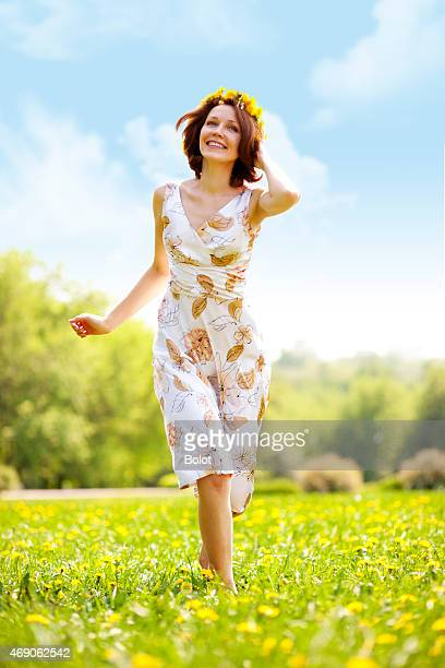 young woman running on grass - green dress stock pictures, royalty-free photos & images