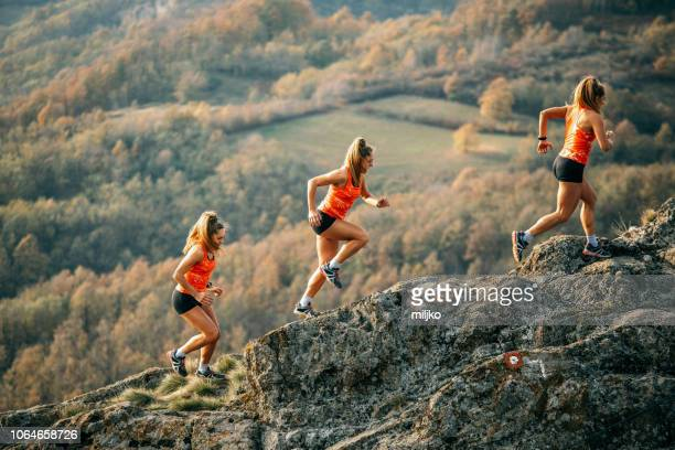 young woman running on mountain - sequential series stock pictures, royalty-free photos & images