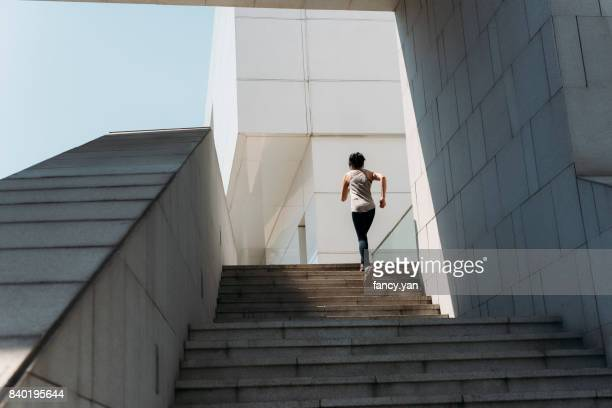 young woman running on the stairs - steps stock photos and pictures