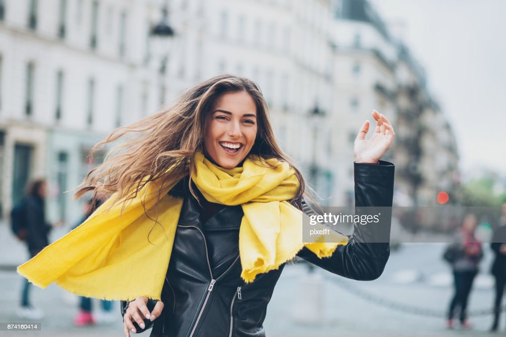 Young woman running on the street : Stock Photo