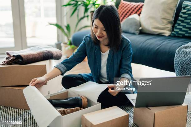 young woman running online business from home - equipment stock pictures, royalty-free photos & images