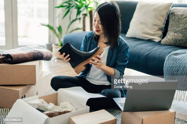 young woman running online business from home - e commerce stock pictures, royalty-free photos & images