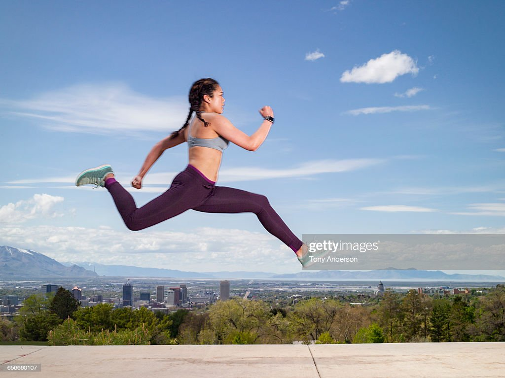 Young woman running outdoors : Stock Photo