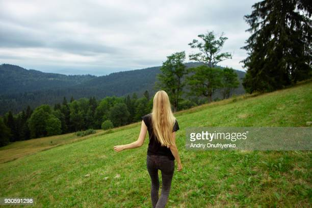 young woman running the hill in mountains - zen like stock pictures, royalty-free photos & images