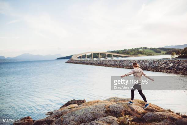 Young woman running to the ocean