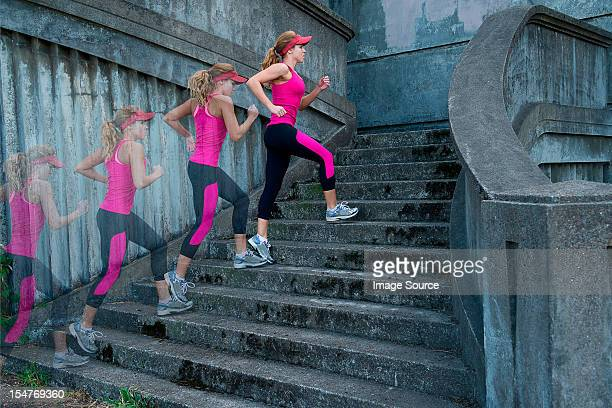 Young woman running up stairs, multiple image