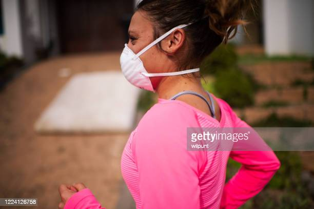 young woman running with face mask chest up - pantyhose mask stock pictures, royalty-free photos & images
