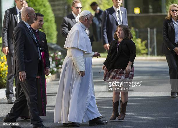 A young woman runs up to greet Pope Francis as he arrives to the Apostolic Nunciature to the United States on September 23 2015 in Washington DC AFP...