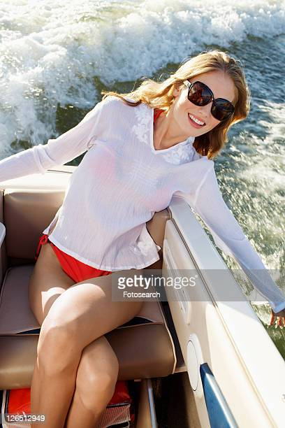Young woman sailing in motorboat (high angle view)