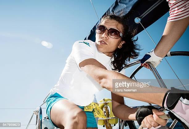 Young woman sailing yacht