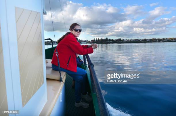 Young woman sails on a yacht over Lake Taupo New Zealand