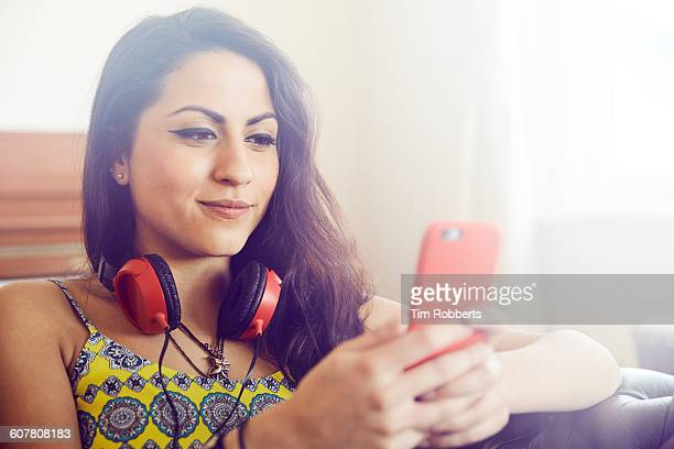 Young woman sat using smart phone