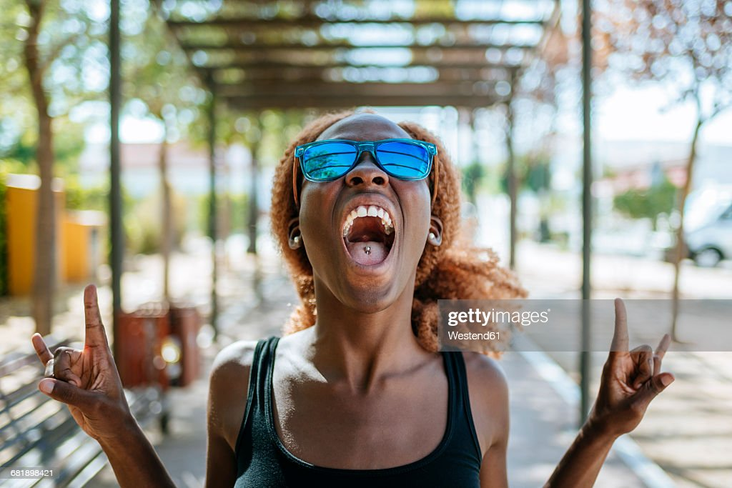 Young woman screaming outdoors : Stock Photo