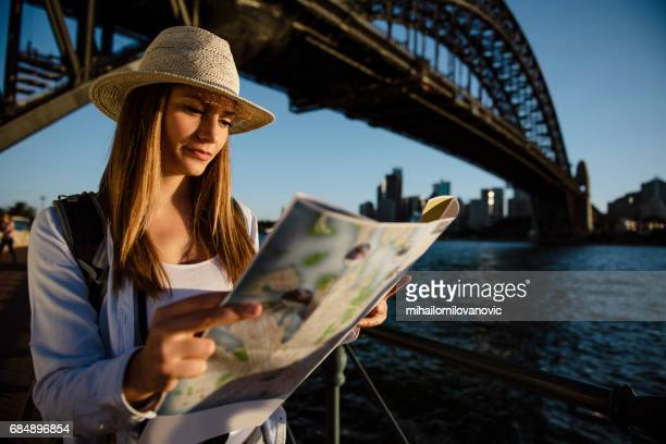 Young woman searching city map