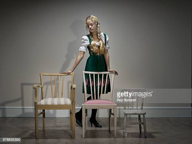 Young Woman Selecting Chairs