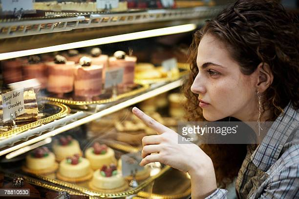 Young Woman Selecting Sweets
