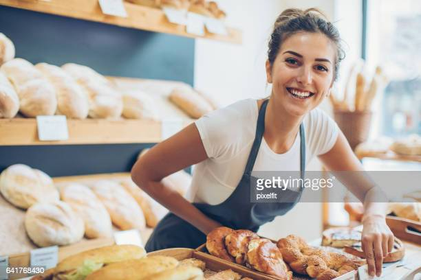 Young woman selling bread and pastry