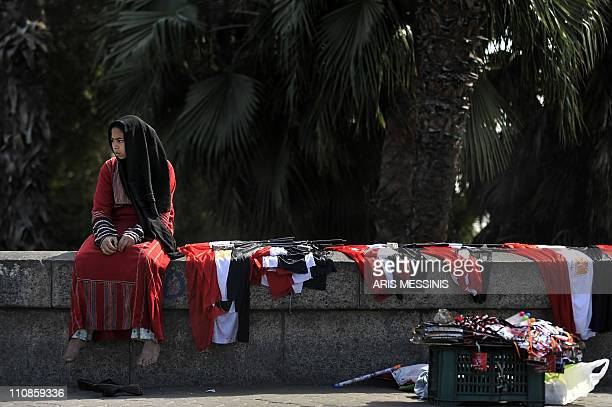 A young woman sells Egyptian flags in central Cairo on March 14 2011 Young militants who spearheaded Egypt's prodemocracy revolution called for a...