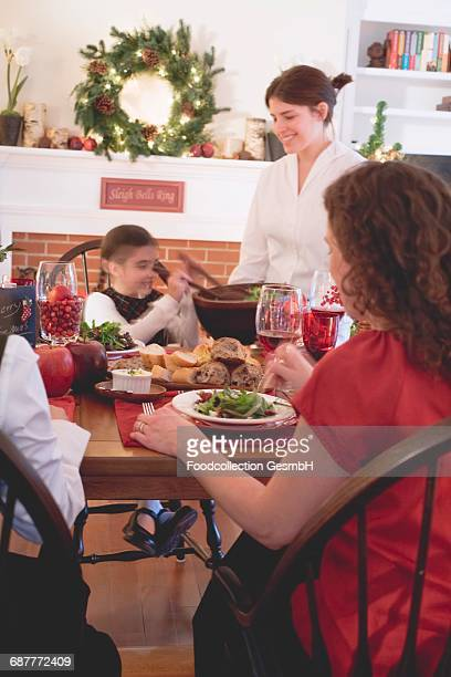 Young woman serving green salad (Christmas)