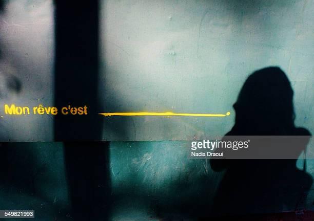 young woman shadow - junge frau allein stock-fotos und bilder