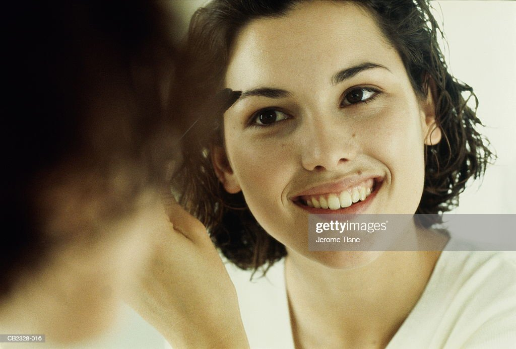 Young Woman Shaping Eyebrows Reflection In Mirror Closeup Stock
