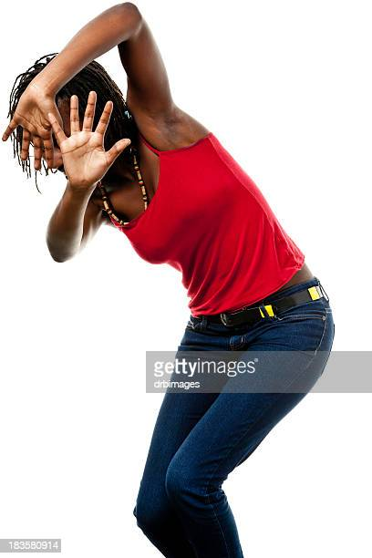 young woman shields herself with hands - spaghetti straps stock pictures, royalty-free photos & images