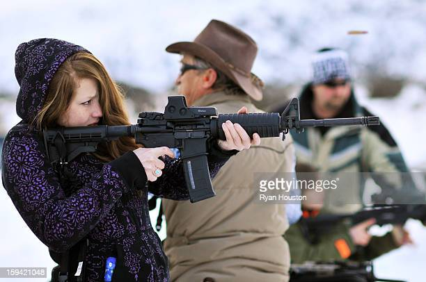 CONTENT] A young woman shoots an assaultstyle rifle at a shooting range The gun has a highcapacity magazine that gun control advocates are trying to...
