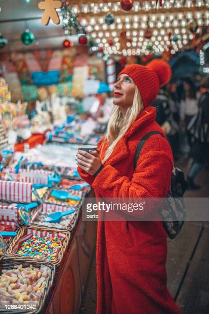 young woman shopping at christmas market - hyde park london stock pictures, royalty-free photos & images