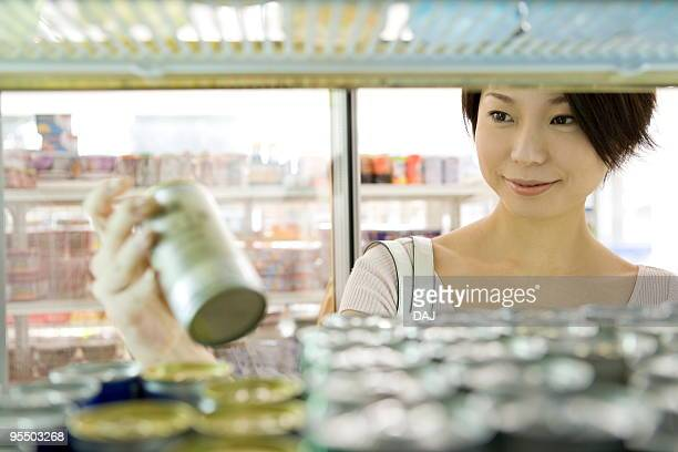 Young woman shopping at convenience store