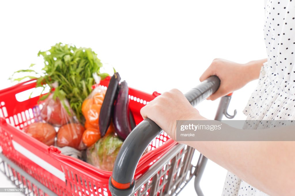 Young woman shopping at supermarket : Stock Photo