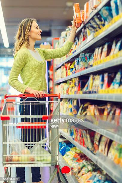 Young Woman Shopping Cereals.