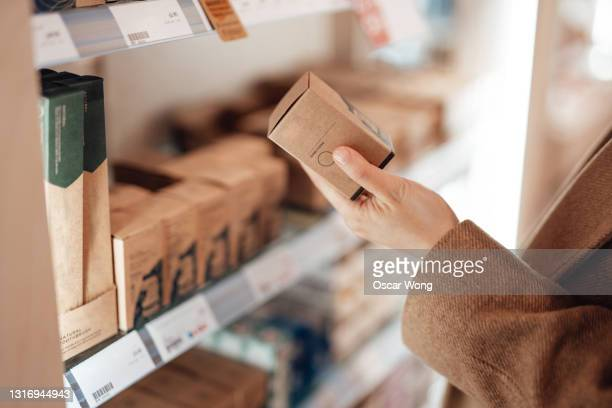 young woman shopping eco friendly personal skincare products in zero waste store - reusable stock pictures, royalty-free photos & images