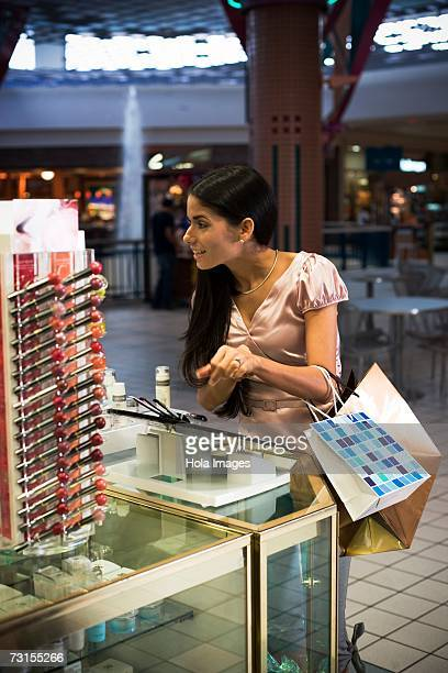 Young woman shopping for beauty products in mall