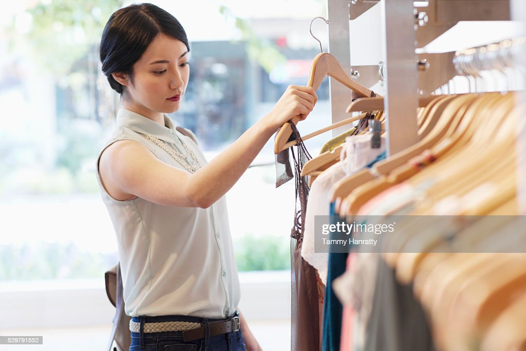 Young woman shopping for clothes : Stock Photo