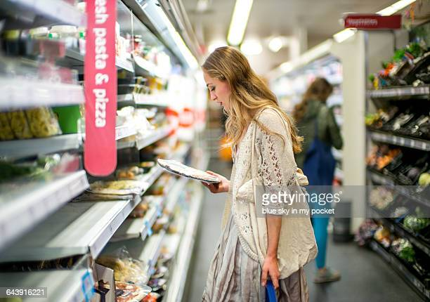 A young woman shopping for food