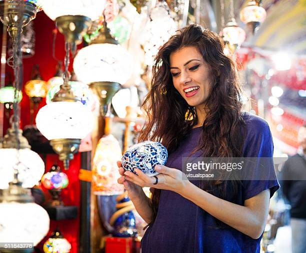 Young Woman Shopping for Gifts in Bazaar