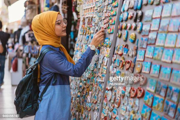 young woman shopping for gifts in bazaar - turkey middle east stock pictures, royalty-free photos & images
