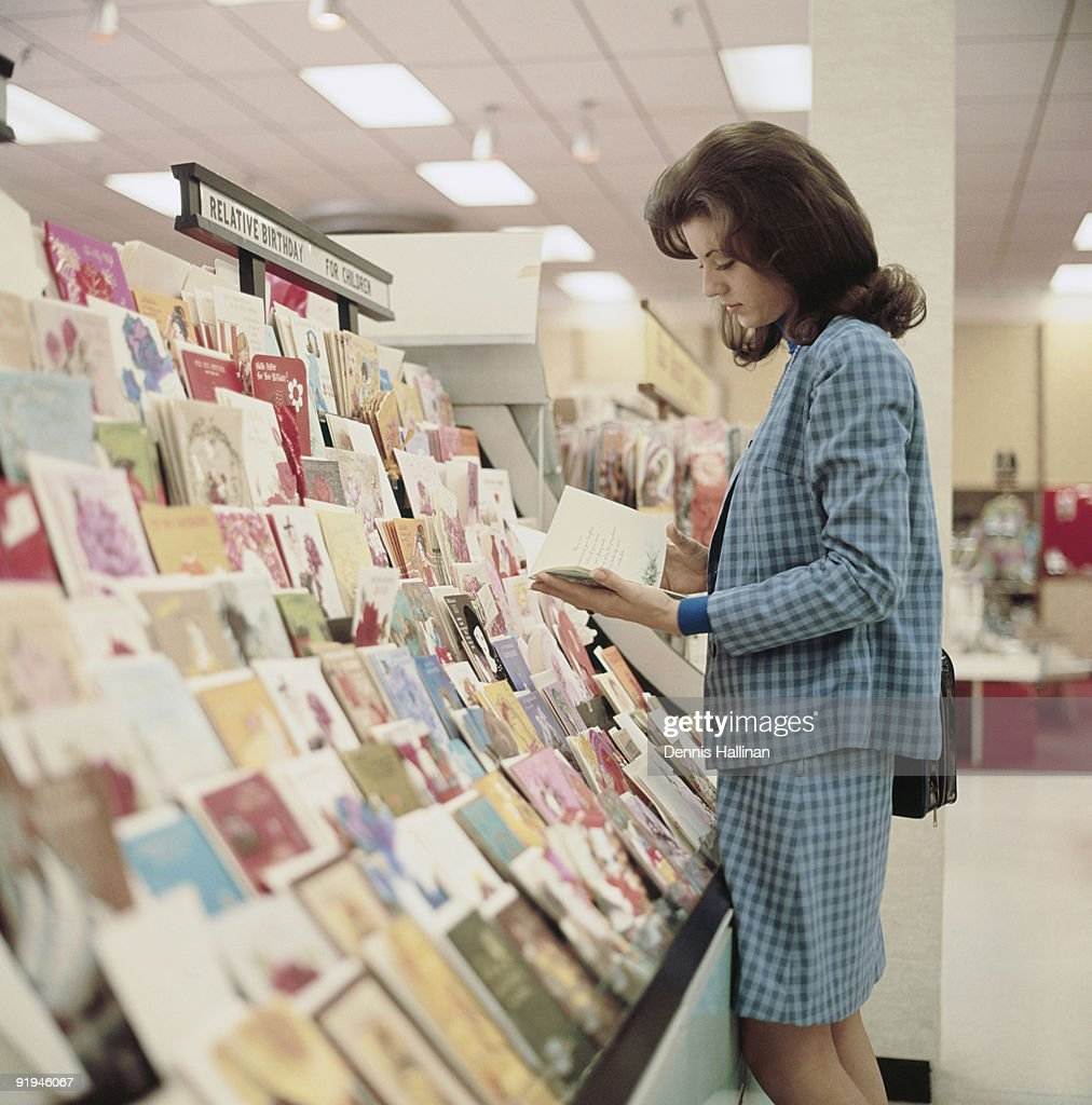 young woman shopping for greeting cards : Stock Photo