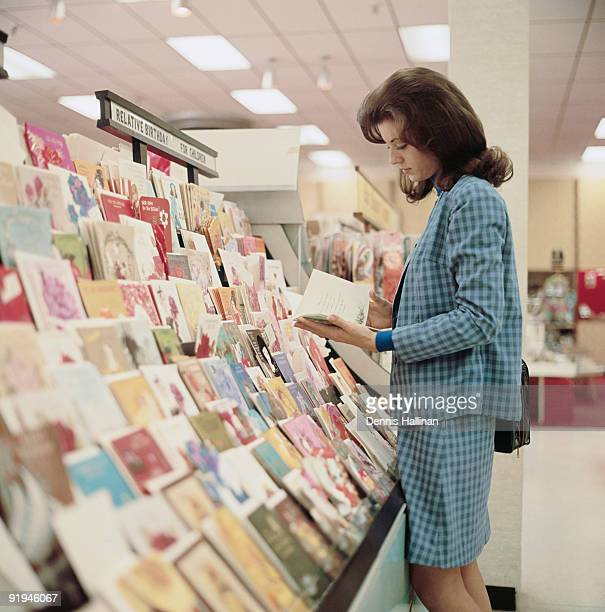 young woman shopping for greeting cards