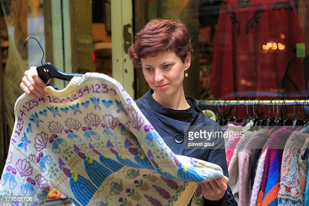 Young woman shopping for vintage clothing